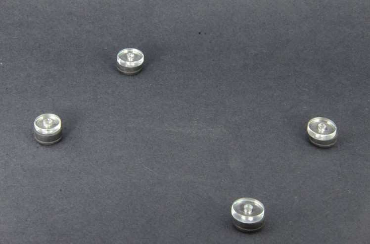 6. Place Washers on top of Rubber Feet
