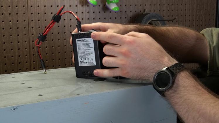 Dual-Lock strips on battery